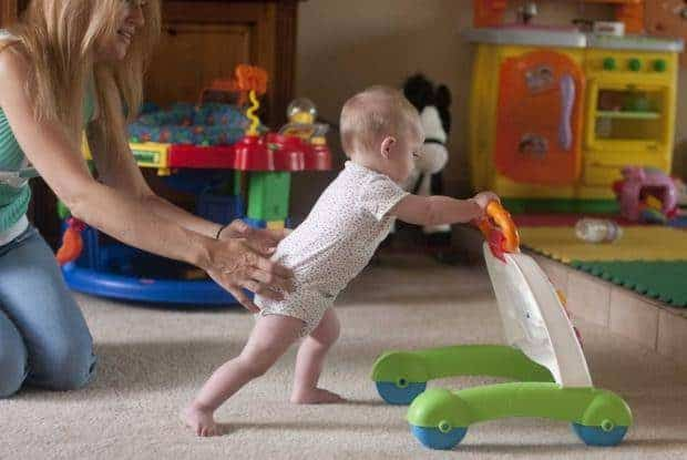 Help baby pushing a walker
