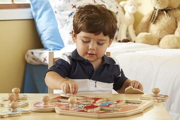 boy-playing-Melissa-Doug-Knob-Puzzle