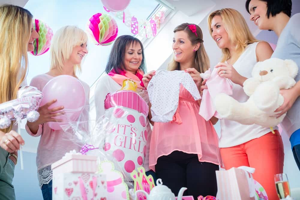 Expecting Mother with presents on baby shower party