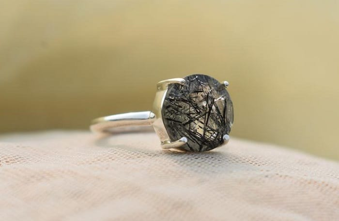 Rutilated quartz meaning black ring