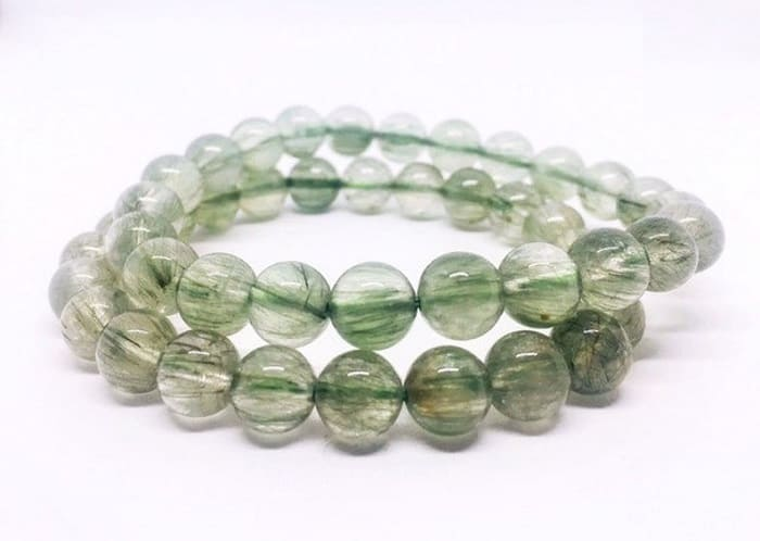 Rutilated quartz meaning green