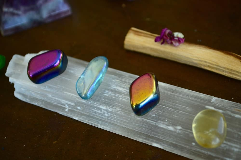 how to cleanse crystals selenite and Rainbow hematite, Clear Quartz, and Aura Quartz